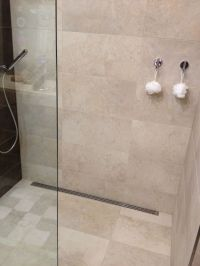 Functional, simple design. Curbless 12x24 tile shower ...