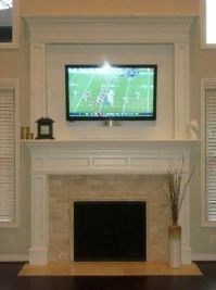 Something like this to cover up the brick fireplace ...