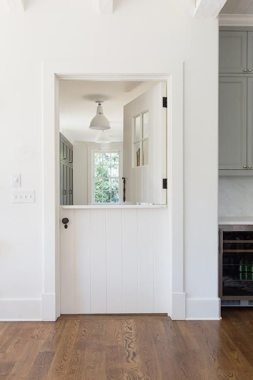 A White Shiplap Dutch Door Opens To A White And Gray