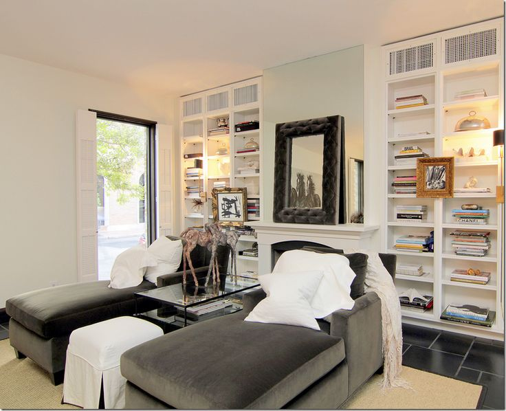 gray chair slipcover banana leaf chairs chaise lounge in front of fireplace and bookshelves | family rooms pinterest reading ...