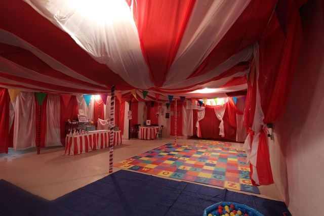 A circus tent built with a staple gun inside an unfinished basement moms can be so resourceful