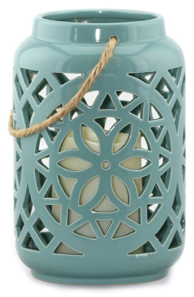 This glossy ceramic lantern complete with a flameless
