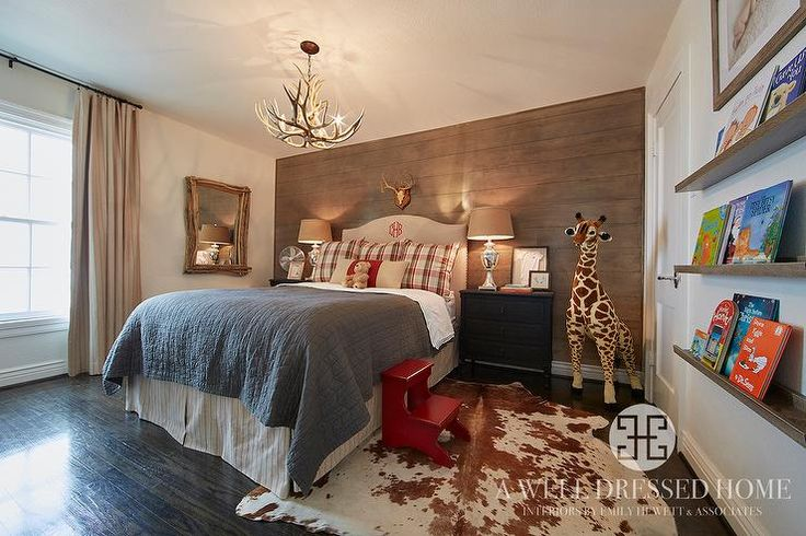 Country cabin boys bedroom features a faux antler