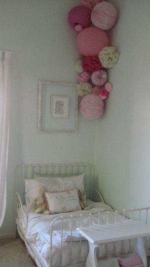 i love the lantern/pom cluster in the corner. snake some white twinkle lights in