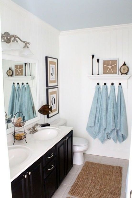 White walls and blue ceiling in this cute bathroom.