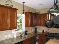 Glazed oak cabinets retain the grain but without the ...