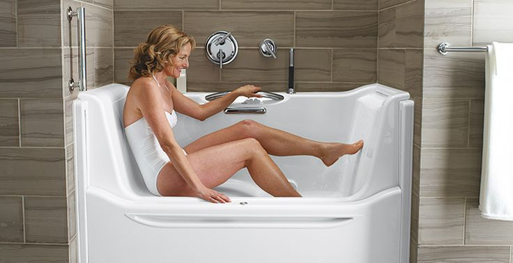 nice universal bathtub design lets you sit  slide into the tub  raise the wall  Bathrooms are
