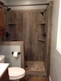 awesome idea - wood tile shower! Have seen the tile before ...
