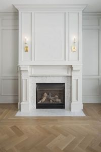 Beautiful millwork on fireplace. If we built up the area
