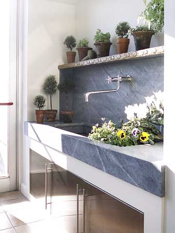 Mudroom – This soapstone counter with a doublewide, extra deep integrated sink is a great asset. With the vegetable garden just