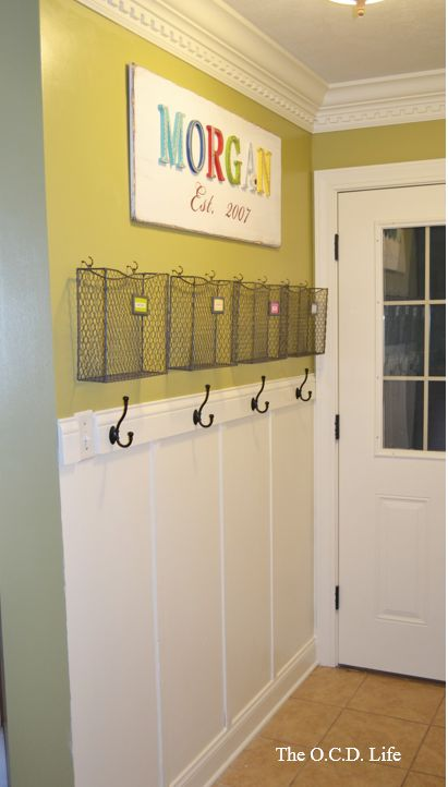 Creating a Family Command Center – love this idea ..all those school papers have a home! Viola!