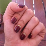 oxblood nails with hint of gold