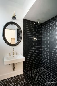 Modern bathroom. Black subway tile, brass fixtures, white ...