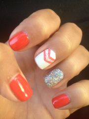 orange nails with chevron and glitter