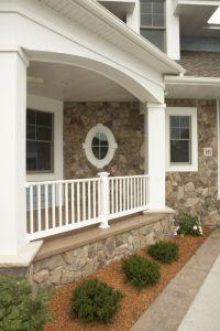 Elegant traditional home exterior, porch, lush greenery ...