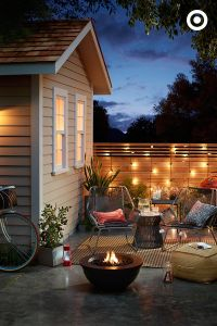 Key to a cozy backyard escape? Set the mood with lighting ...