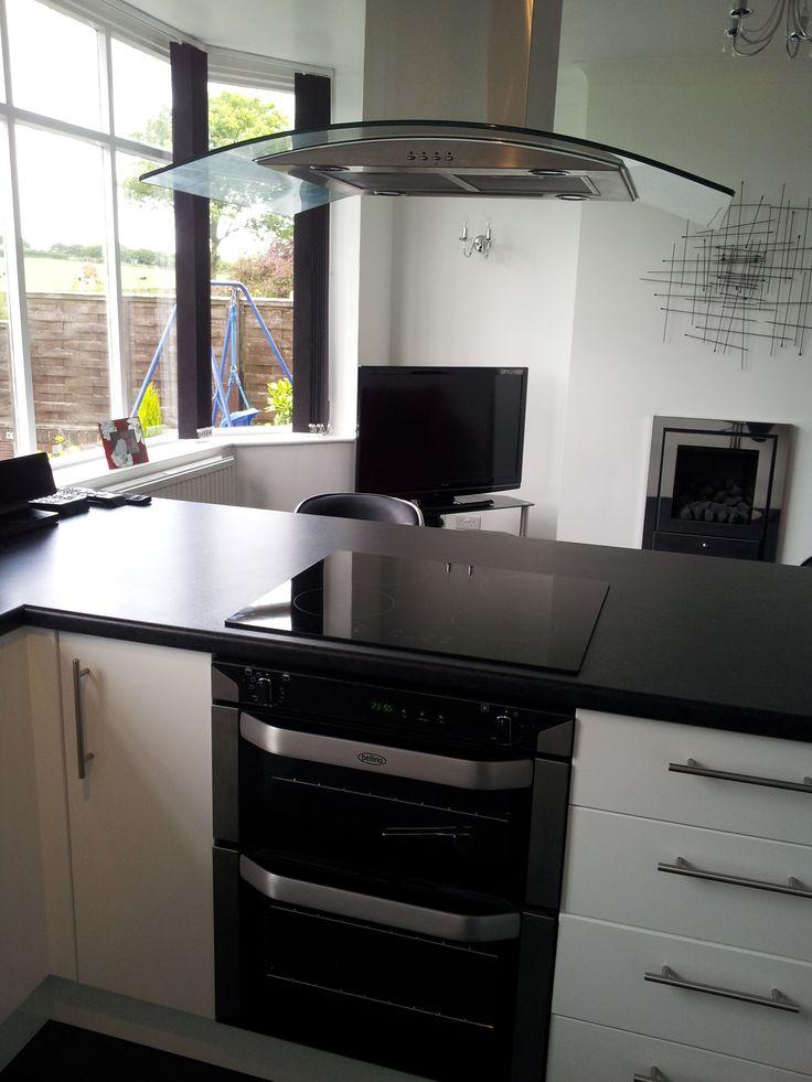 Sleek modern black  white kitchen with breakfast bar