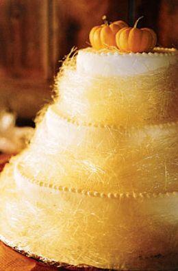 Fall wedding cake idea with spun sugar and mini pumpkin topper