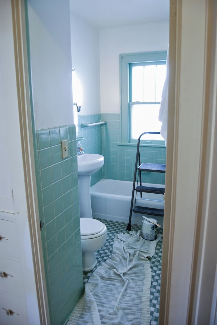 Bathroom gets an overhaul Fresh white paint with seafoam