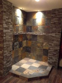 Corner fireplace we finished in slate and ledger stone ...