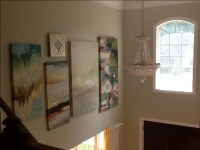Two story foyer; large painting gallery wall