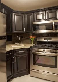 My next kitchen. Dark grey cabinets with dark backsplash ...