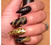 black and gold stiletto nails