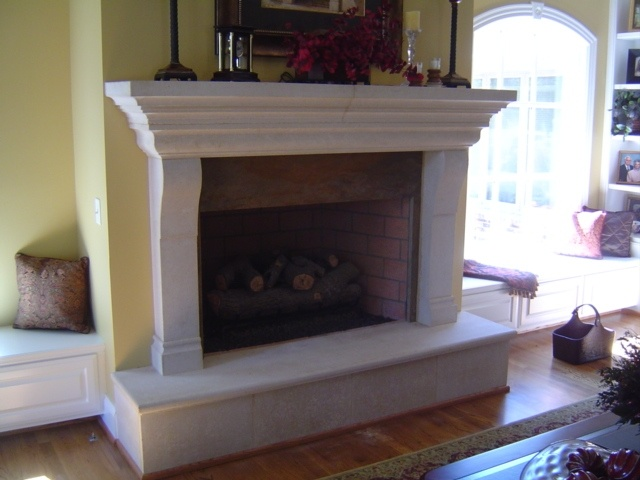 Idea for Upstairs Fireplace Drywall over brick and add some cabinets underneath  Decor