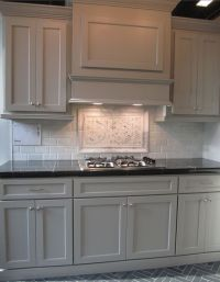 gray cabinets; black counters; slate herringbone floor ...
