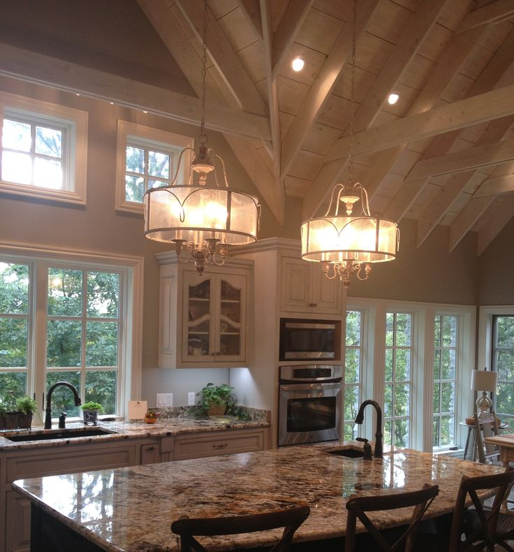 French country gray glazed cabinets white washed vaulted