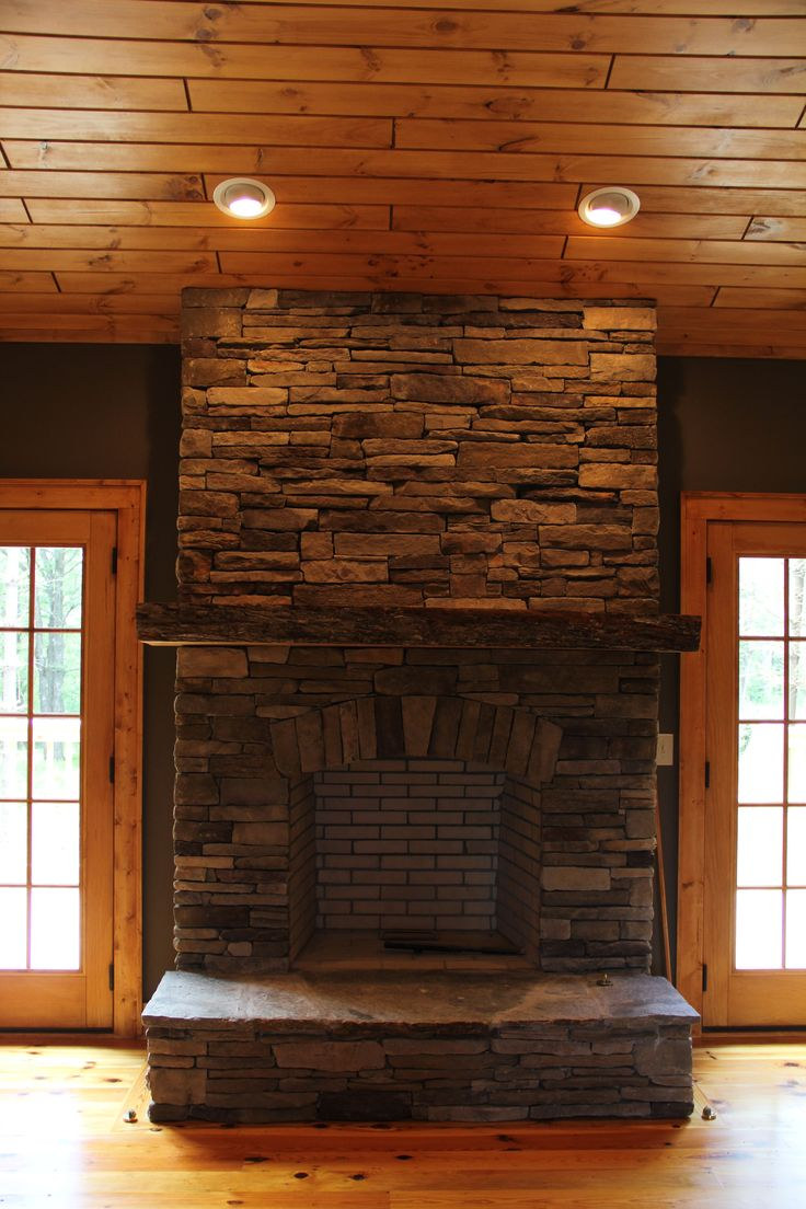 Stacked stone fireplace with rustic maple mantle VPC Builders Blowing Rock NC home builder