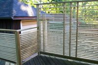 Pressure treated horizontal slat deck screen and deck