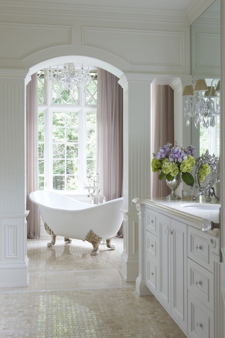 Fabulous & classic bathroom – This pretty claw foot tub sits in a niche with a lovely view!