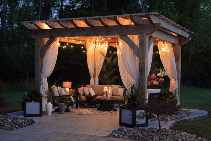 This Sophisticated Outdoor Room Is Furnished With A