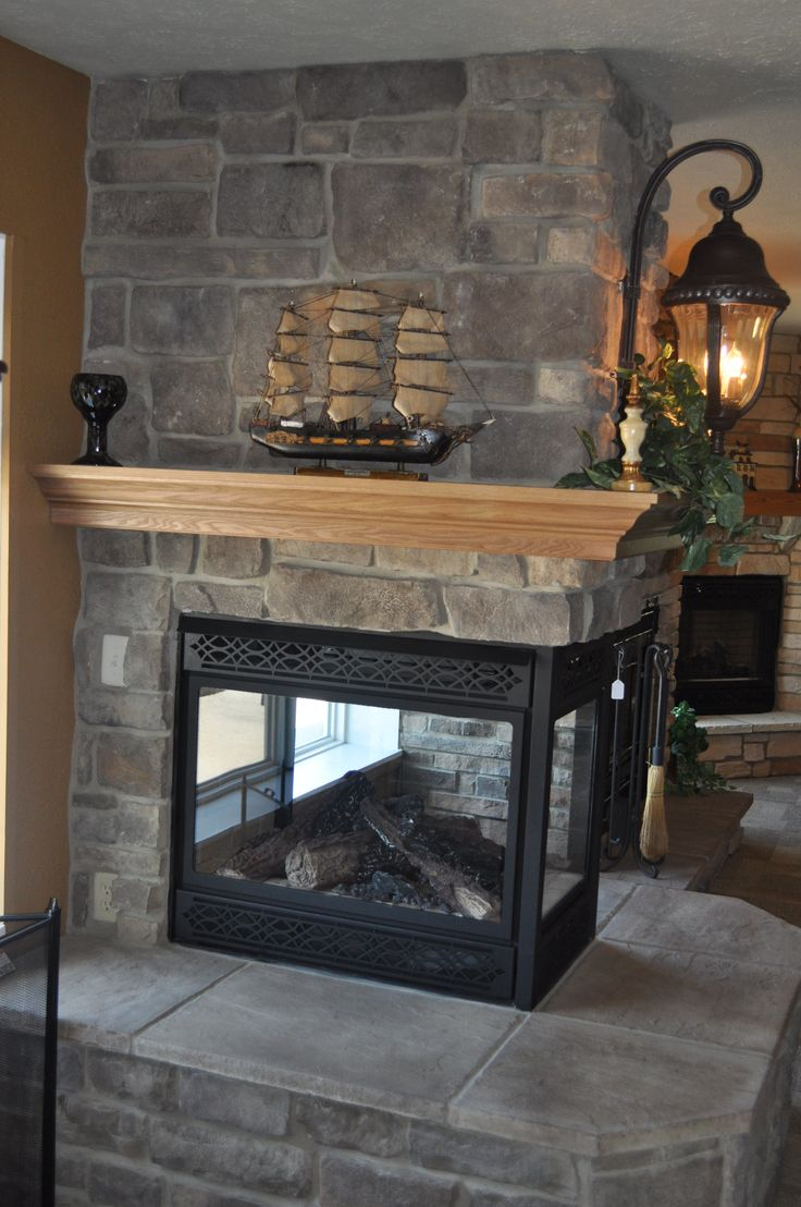 Stoned Fireplace with see through fireplace and Crown Oak Wrap around Mantle Price Cut Cobble J