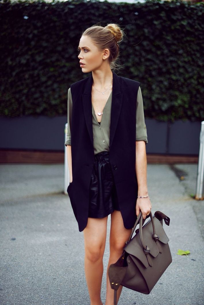 W/ army green top, delicate necklaces, black skirt: