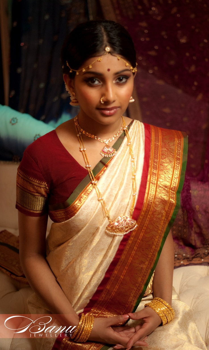 traditional South Indian tamil Bride wearing bridal saree and jewellery Indian wedding