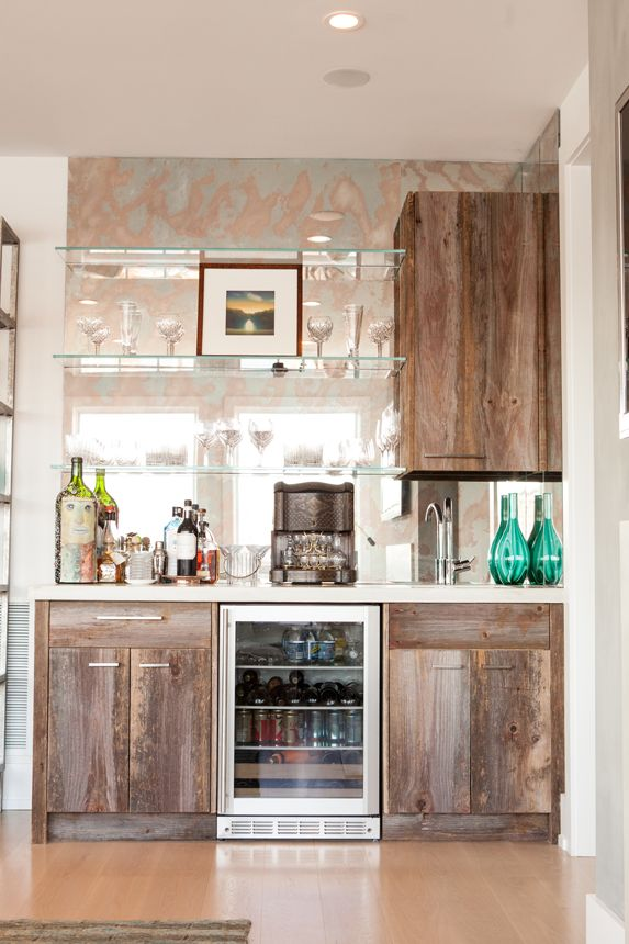 Antique barn board wet bar with glass shelves and antique