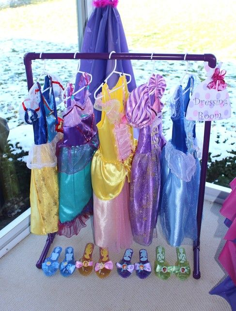 Create a disney princess dressing room at your childs birthday party so all her royal guests can play dress up. Perfect activity idea for princess themed birthday