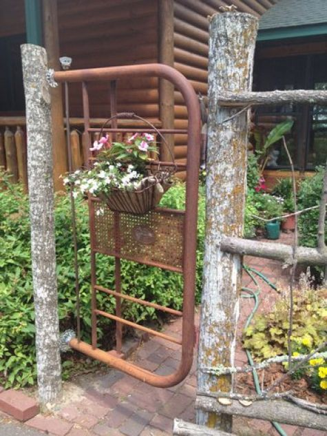 Old Metal Headboard…re-purposed into a rustic garden