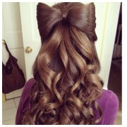 brown curly hair with bow