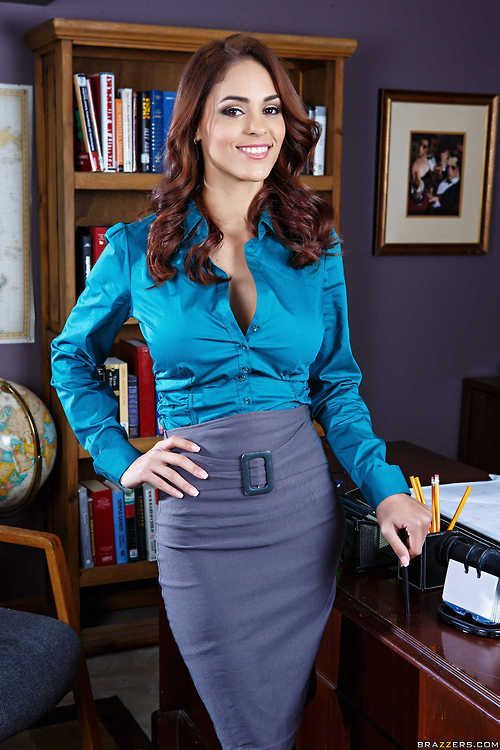 This grey belted pencil skirt and teal blouse make a nice
