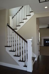 Open railing with hardwood stairs. We love how the dark ...