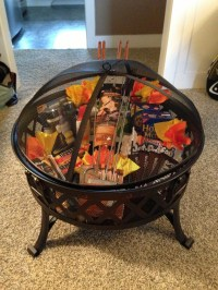 Silent auction basket ... Fire pit, roasting sticks and ...