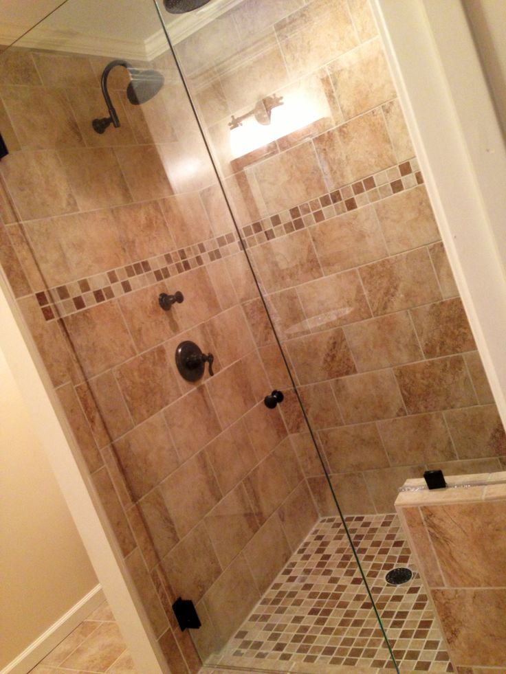 Guest bathroom tile shower Beige tile shower with bench