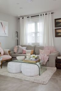 Gray & Pink Living Room with white poufs under glass ...
