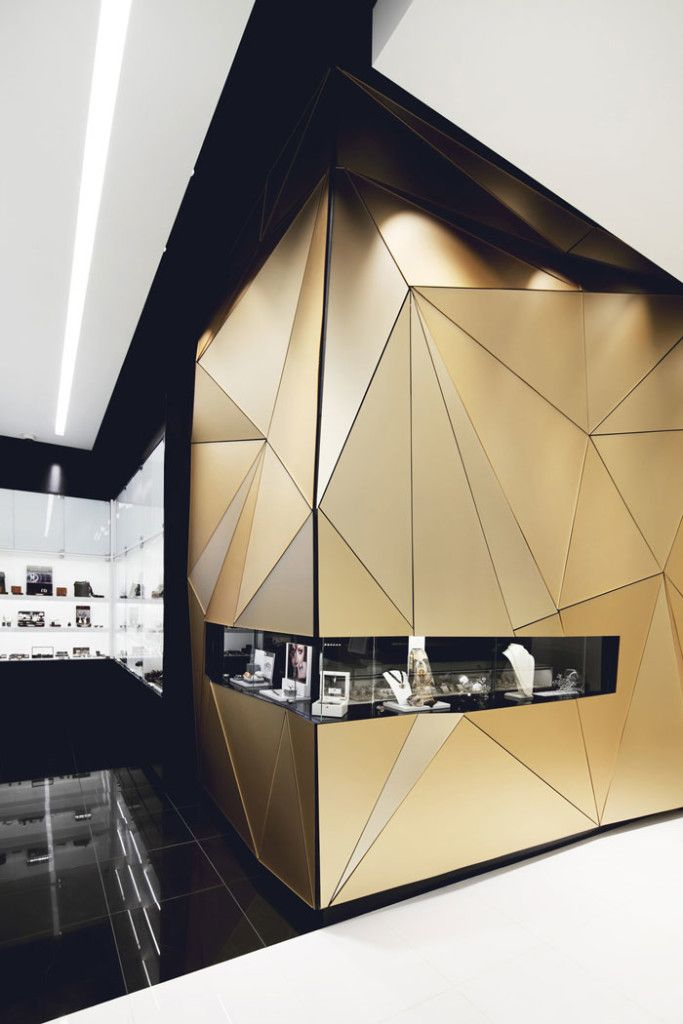 Interior Architecture: beautiful gold faceted front window of Boutique Penelope by Hatem+D: