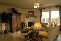 Living room arrangement with corner fireplace. This is ...