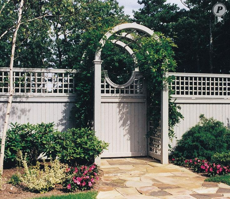 Arched arbor with moon gate and English Trellis fence