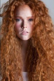 beautiful long curly redhead